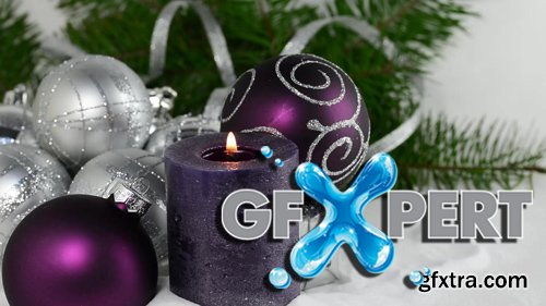Christmas background with candle and decorations.Purple and silver Christmas balls over fir tree branches in the snow